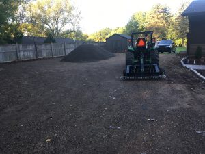 The start of a gravel drive way with 56 tons of trap rock (Before)